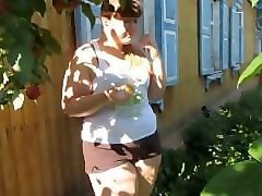 fat girl pissing in the garden
