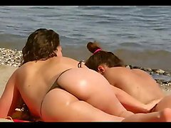 soon the summer) girls rest on the beach
