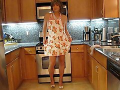 sexy crossdresser plays in the kitchen